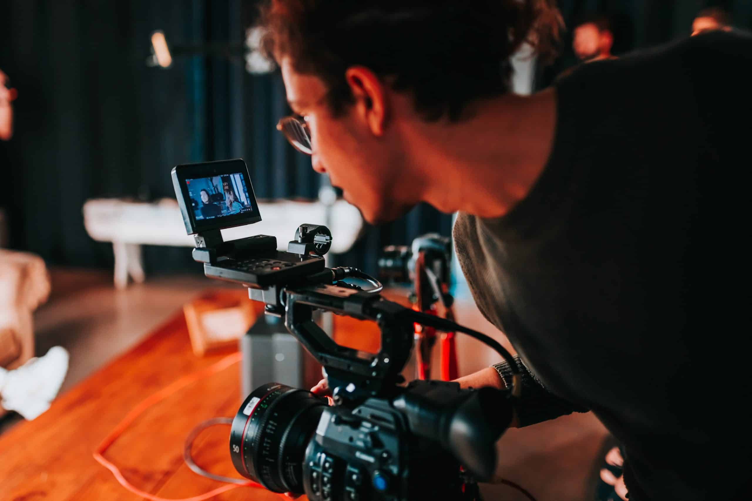 photo of a man holding video camera 2608519